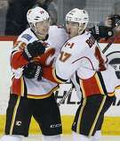 Calgary Flames' Alex Chiasson (39) and Lance Bouma (17) celebrate Chiasson's goal against the Winnipeg Jets during the third period of an NHL hockey game Saturday, March 11, 2017, in Winnipeg, Manitoba. (John Woods/The Canadian Press via AP)