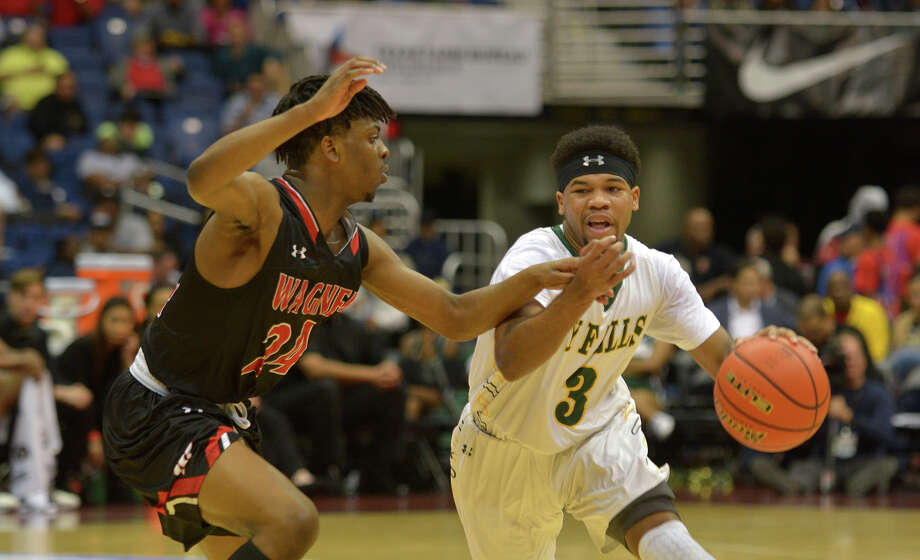 Cy Falls junior guard Trajan Wesley (3) drives against San Antonio Wagner freshman forward Journee Phillips (24) during the 2nd quarter of their Class 6A state final at the Alamodome in San Antonio on Saturday, March 11, 2017. (Photo by Jerry Baker/Freelance) Photo: Jerry Baker, Freelance / Freelance