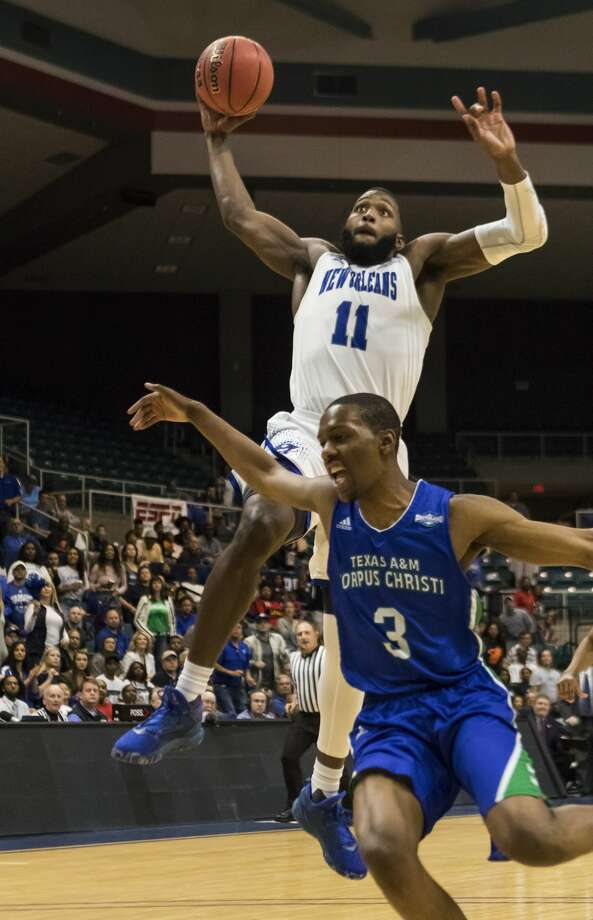 New Orleans' Michael Zeno (11) attempts a dunk against Texas A&M-Corpus Christi during the first half of an NCAA college basketball game for the championship of the Southland Conference tournament Saturday, March 11, 2017, in Katy, Texas. (AP Photo/Joe Buvid) Photo: Joe Buvid/Associated Press