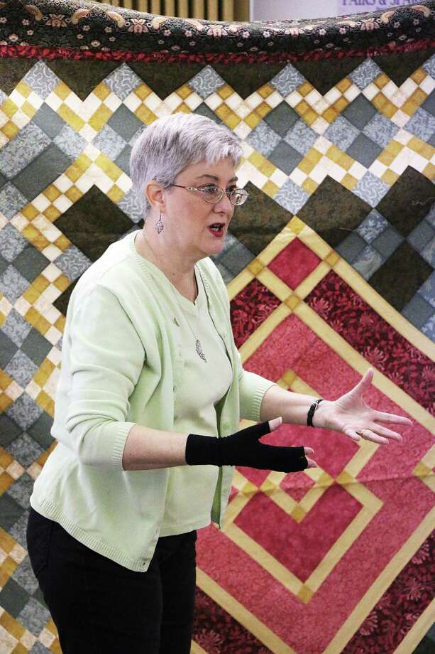 Lecturer and pattern designer Minay Sirois discusses colors, the use of light and dark, and various techniques to help design patterns for quilts. Photo: David Taylor