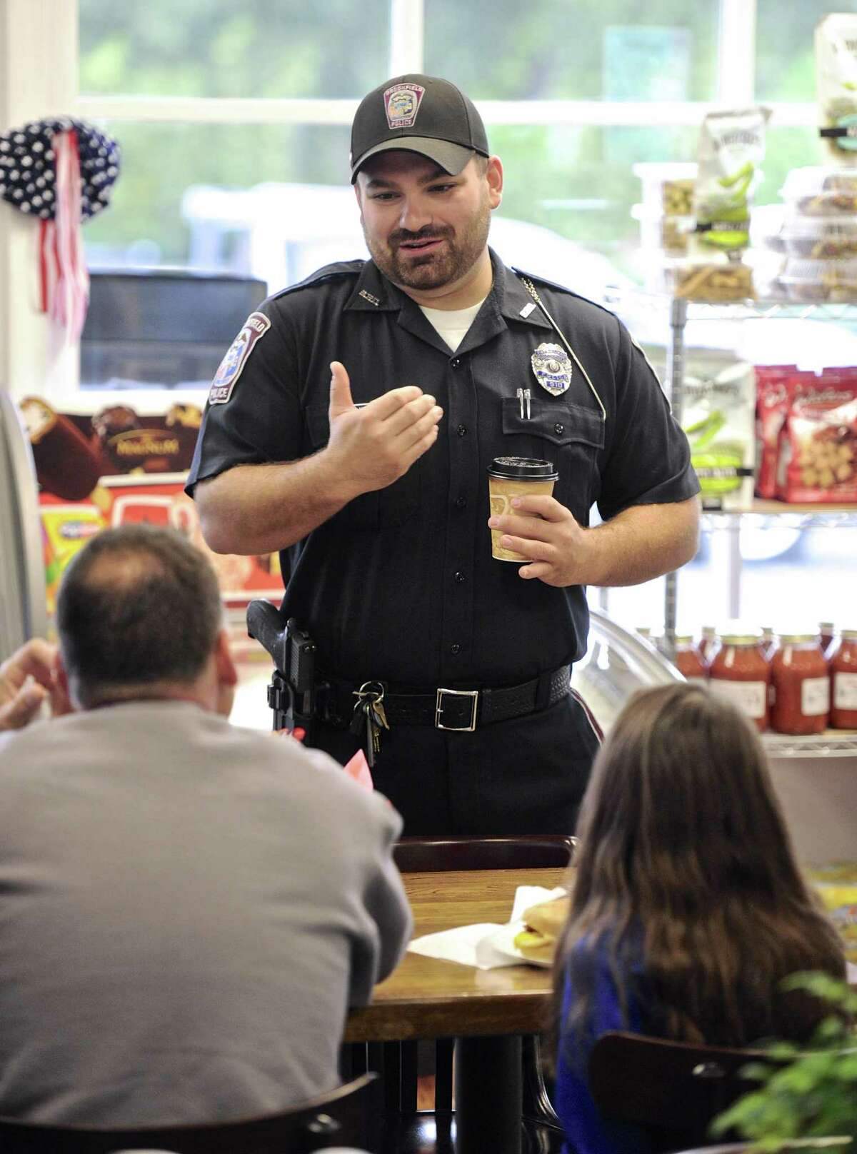 Officer Joe Kyek talks with customers of Brookfield Deli and Catering. Members of the Brookfield Police Department were at the deli for breakfast, and to have a chance to meet and talk with residents. Saturday, October 8, 2016, in Brookfield, Conn.