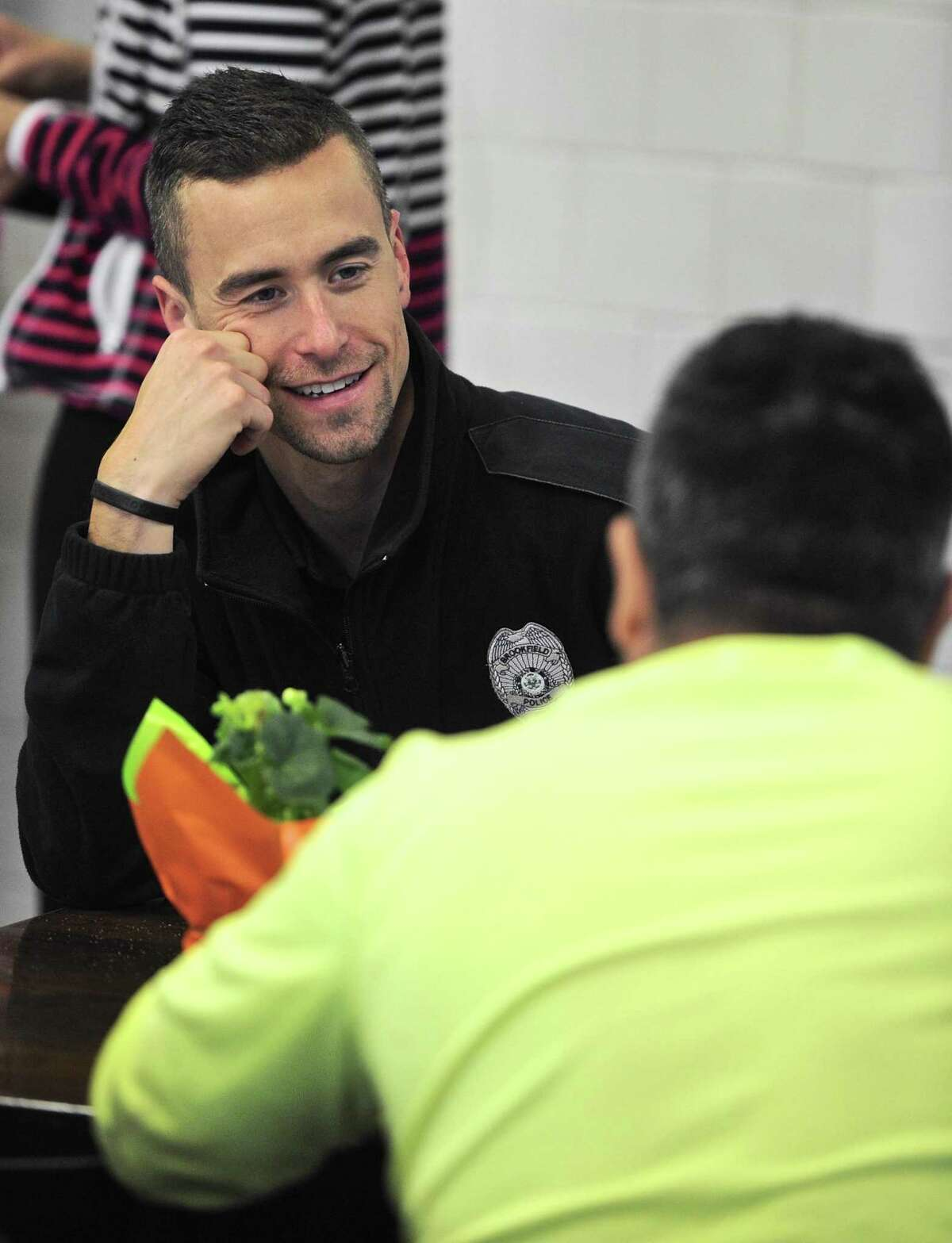 Officer Mitch Heller talks with a customer of Brookfield Deli and Catering. Members of the Brookfield Police Department were at the deli for breakfast, and to have a chance to meet and talk with residents. Saturday, October 8, 2016, in Brookfield, Conn.