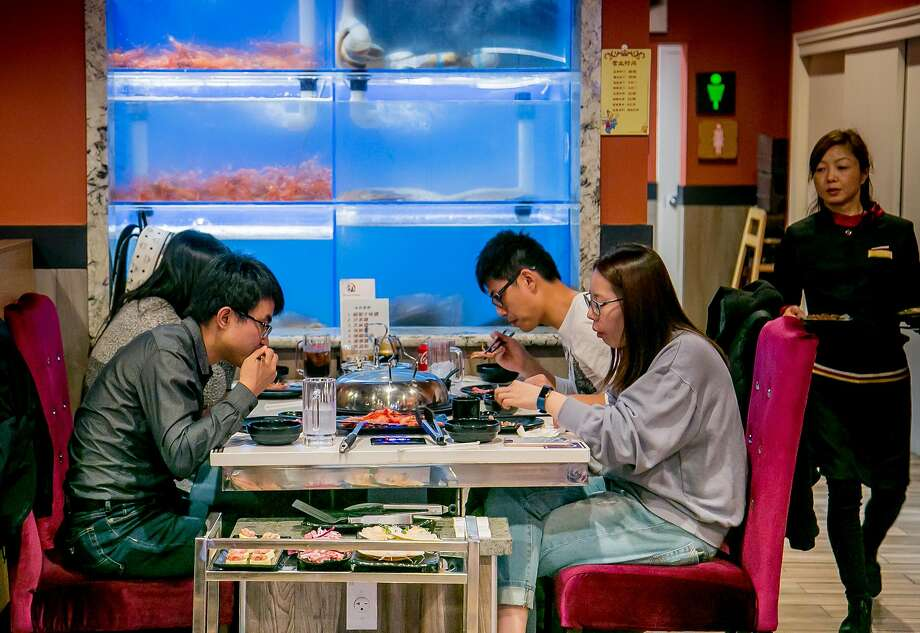 People have dinner at Tastee Steam Kitchen in Oakland, Calif., Calif. on March 11th, 2017. Photo: John Storey, Special To The Chronicle