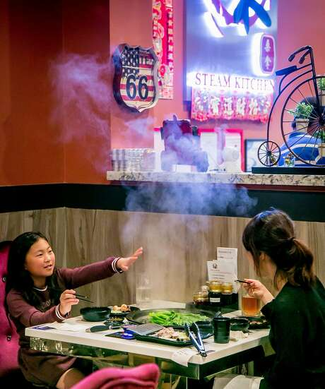 People have dinner at Tastee Steam Kitchen in Oakland. Photo: John Storey, Special To The Chronicle
