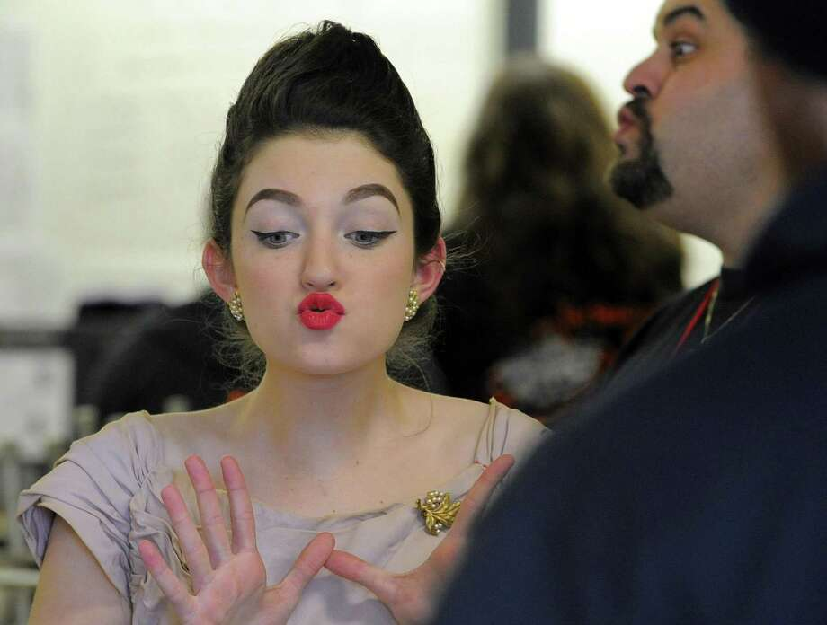 Cara Grasso, a student performer from Stamford High School Strawberry Hill Players warms up with a facial exercise prior to performing a scene from 'The Actor's Nightmare' in the Connecticut Drama Association 81st Annual Connecticut State Theatre Festival at Westhill High School in Stamford, Conn. on Saturday, March 11, 2017. Ten Connecticut High Schools presented a short one act play, in which student actors and tech teams were assess in their theatrical performance, technical and stage management skills. Photo: Matthew Brown / Hearst Connecticut Media / Stamford Advocate