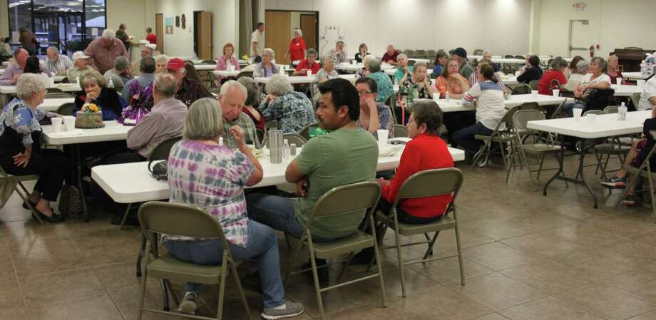Visitors enjoy each other's company and a nice meal at the Cleveland Senior Center's March 10 fundraiser. Photo: Jacob McAdams