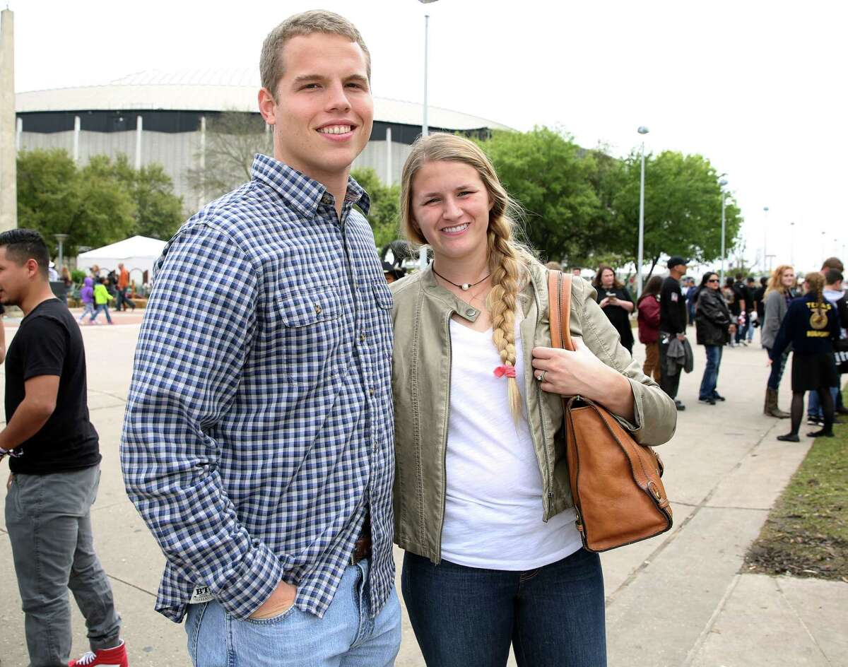 People pose for a photo at Houston Livestock Show and Rodeo Sunday, March 12, 2017, in Houston.