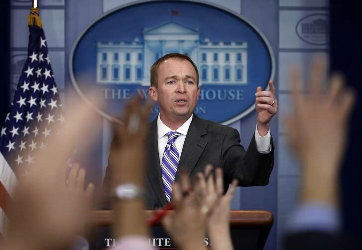 FILE - In this Feb. 27, 2017, file photo, budget director Mick Mulvaney speaks to reporters at the White House in Washington. President Donald Trump unveils a proposed budget on March 16 that will sharply test Republicans' ability to keep longstanding promises to beef up the military by making politically painful cuts to a lengthy list of popular domestic programs. (AP Photo/Manuel Balce Ceneta, File)