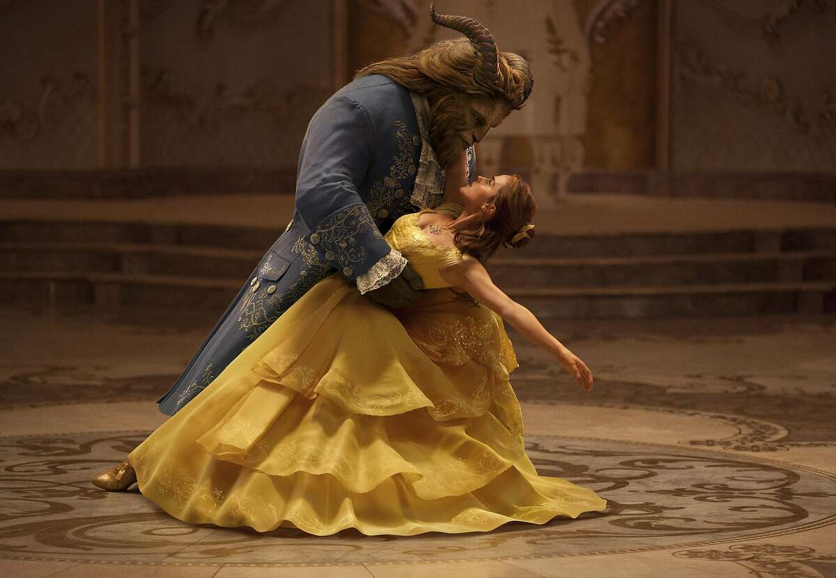 This image released by Disney shows Dan Stevens as The Beast, left, and Emma Watson as Belle in a live-action adaptation of the animated classic
