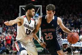 LAS VEGAS, NV - MARCH 07:  Joe Rahon #25 of the Saint Mary's Gaels drives against Josh Perkins #13 of the Gonzaga Bulldogs during the championship game of the West Coast Conference Basketball Tournament at the Orleans Arena on March 7, 2017 in Las Vegas, Nevada. Gonzaga won 74-56.  (Photo by Ethan Miller/Getty Images)