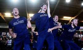 Members of the St. Mary's basketball team celebrate their victory of being selected for the NCAA tournament on Sunday, March 12, 2017, in Moraga, Calif.