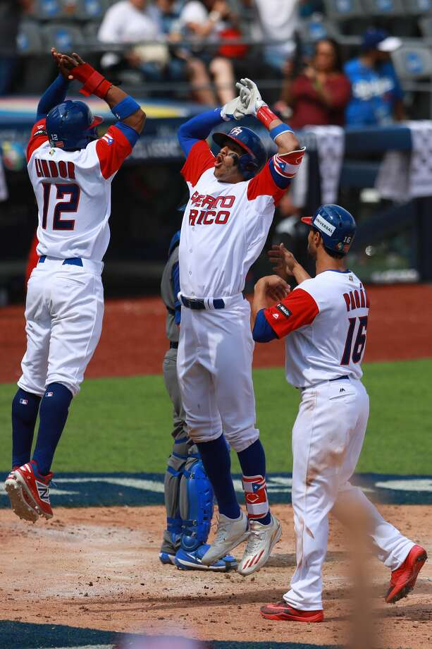 ZAPOPAN, MEXICO - MARCH 12: Carlos Correa #1 of Puerto Rico celebrates after hitting a home run in the bottom of the fourth inning during the World Baseball Classic Pool D Game 5 between Italy and Puerto Rico at Panamericano Stadium on March 12, 2017 in Zapopan, Mexico. (Photo by Miguel Tovar/Getty Images) Photo: Miguel Tovar/Getty Images