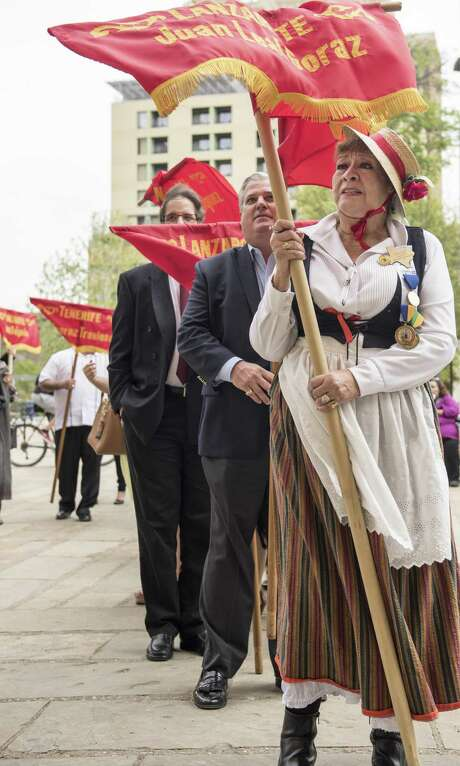Alicia Calderon a member of Canary Islands Descendants Association  commemorates the arrival of their ancestors in San Antonio on Sunday, March 12, 2017, at San Fernando Cathedral. Some members of the association dressed in full historical attire and carry banners representing the original sixteen families who established the first civil government in San Antonio. Photo: Carlos Javier Sanchez | For The Express News / Carlos Javier Sanchez | For The Express News / Carlos Javier Sanchez | For The Express News