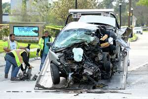 Tow truck drivers load the wreckage of a silver Honda that crashed and killed its driver in a high speed chase along Kingsland Blvd. near Houghton Rd. in Katy on Sunday, March 12, 2017
