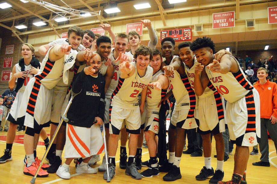 40527ca5f00c Members of the Edwardsville boys  basketball team celebrate after knocking  off Danville in the Class