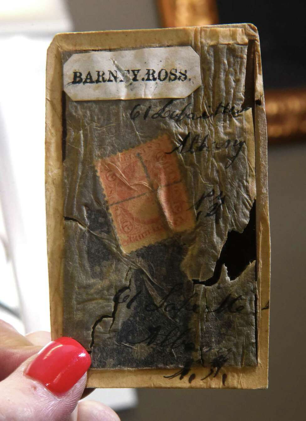 A stamp is seen in the back side of a tintype of Civil War Private Bernard Ross,