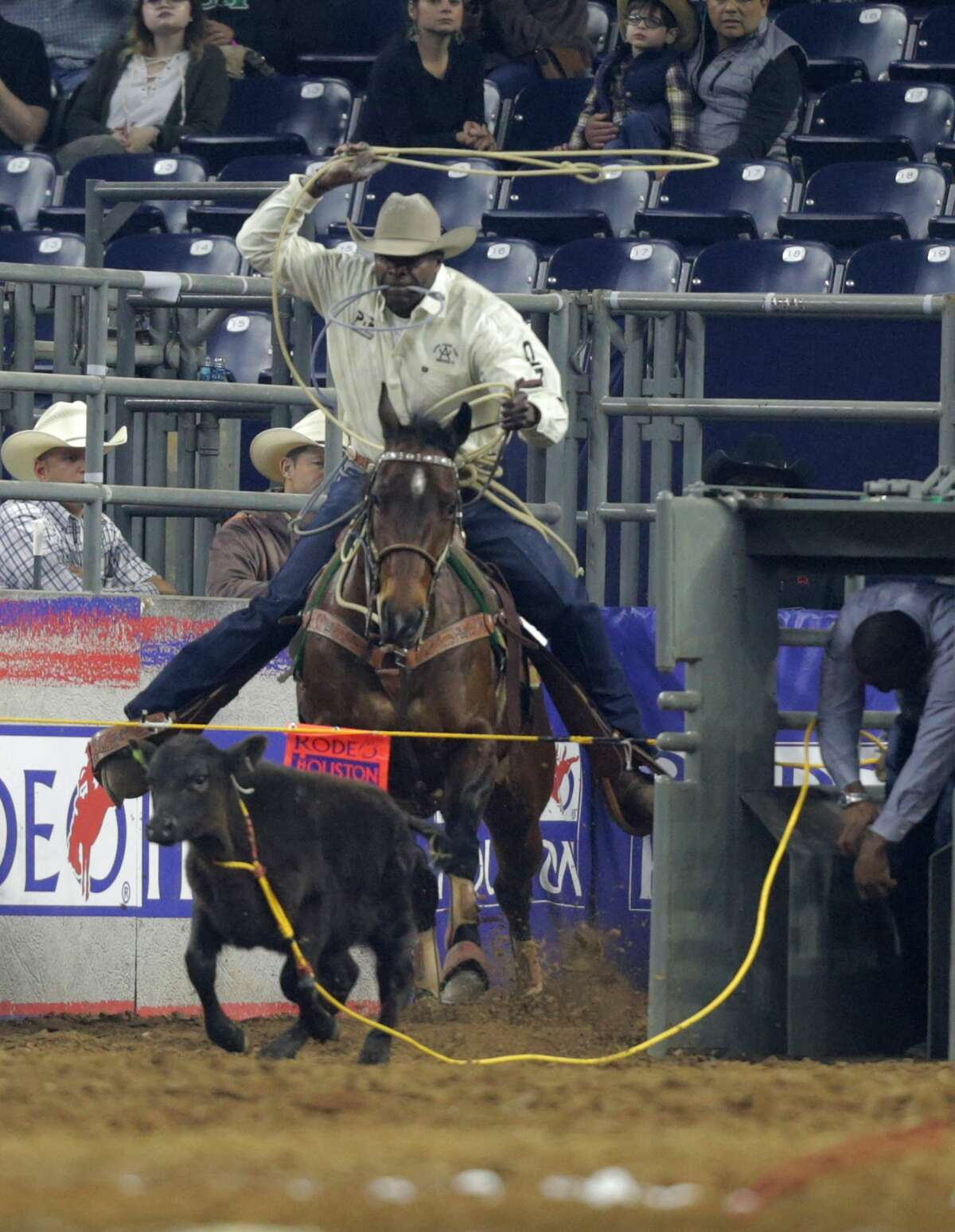 Fred Whitfield of Hockley, Texas prepares to rope a calf during the tie-down roping competition. Whitfield placed first. Rodeo Houston at NRG on Sunday, March 12, 2017, in Houston. ( Elizabeth Conley / Houston Chronicle )