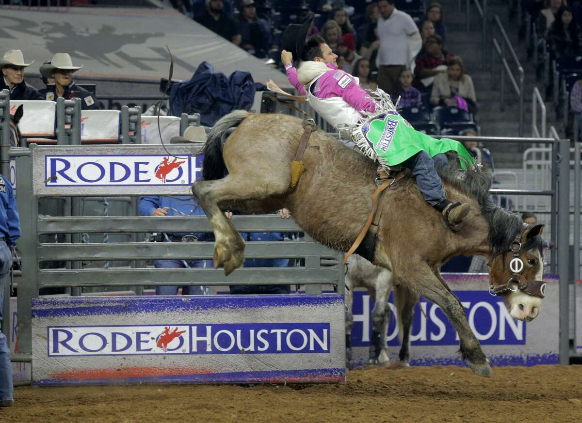 Clint Cannon competes in the bareback riding competition during the Rodeo Houston at NRG on Sunday, March 12, 2017, in Houston. ( Elizabeth Conley / Houston Chronicle )