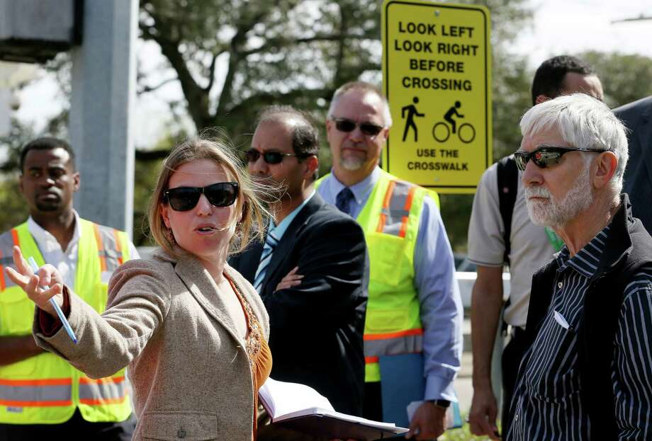 Mary Blitzer, advocacy director for BikeHouston, offers suggestions on potential improvements that could be made at Sunset and Main to make the intersection safer for bikers and pedestrians crossing lanes of traffic and rail lines. Photo: Yi-Chin Lee, Staff / © 2017  Houston Chronicle