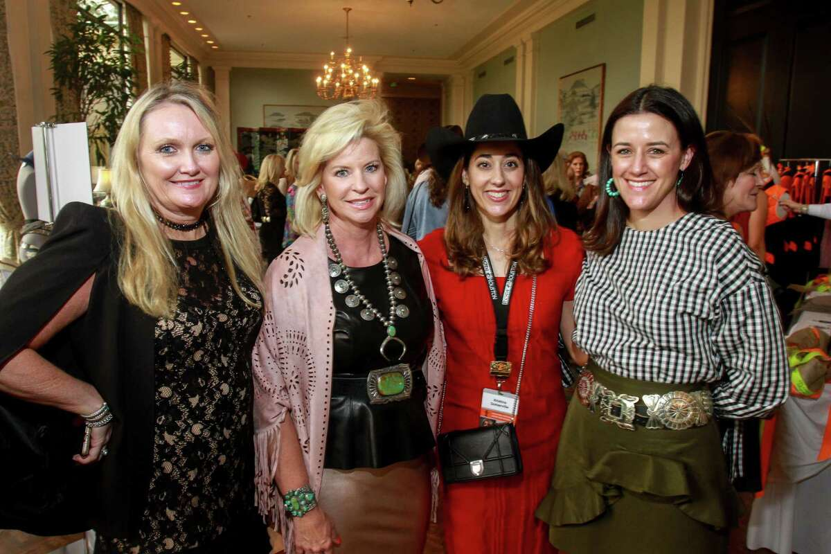 Jill Watson, from left, Julie Shannon, Kristina Somerville and Ashley Pearce at the Houston Livestock Show and Rodeo's fashion show and luncheon. (For the Chronicle/Gary Fountain, March 11, 2017)