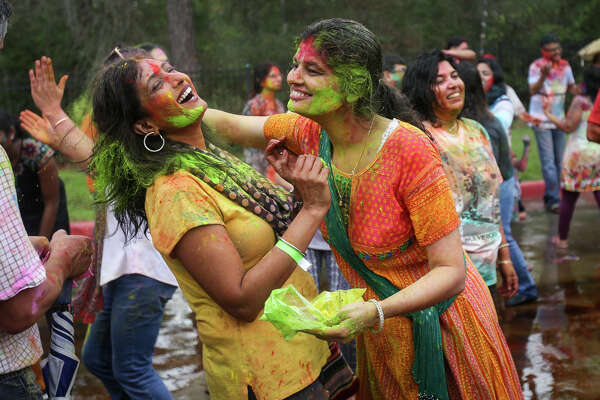 Shilpi Veludandi, right, smears colored powder onto Anjali Reddy's face during the Holi festival on Saturday, March 11, 2017, at the Hindu Temple of The Woodlands.