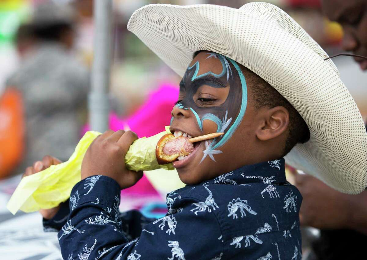 Gregory Brown Jr., 6, of Houston, has a jumbo corn dog at the Houston Livestock Show and Rodeo Wednesday, March 8, 2017, in Houston.