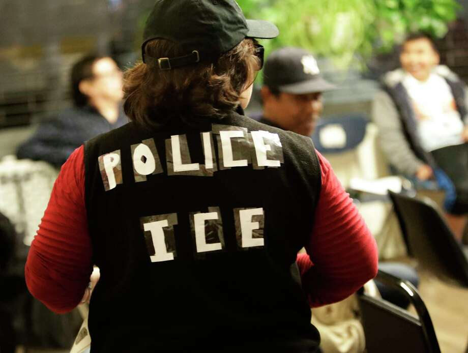 In this March 7, 2017 photo, a volunteer takes part in role play during a know-your-rights training session by the pro-immigrant advocacy group Make the Road New York, in the Queens borough of New York. Advice that's being drummed into immigrants around the country, at trainings includes not opening the door if ICE knocks, not even a little bit. If you're taken into custody, tell them your name and nothing else and don't sign anything.  (AP Photo/Frank Franklin II) ORG XMIT: NYFF201 Photo: Frank Franklin II / Copyright 2017 The Associated Press. All rights reserved.