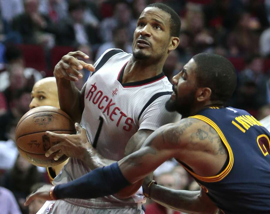 Cleveland Cavaliers guard Kyrie Irving (2) knocks the ball away from Houston Rockets forward Trevor Ariza (1) during the second quarter of an NBA basketball game at Toyota Center on Sunday, March 12, 2017, in Houston. ( Brett Coomer / Houston Chronicle ) Photo: Brett Coomer/Houston Chronicle