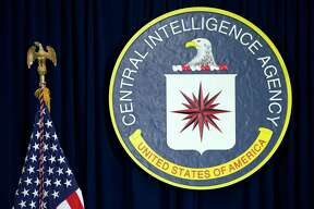 FILE - This April 13, 2016, file photo shows the seal of the Central Intelligence Agency at CIA headquarters in Langley, Va. WikiLeaks' release of nearly 8,000 documents that purportedly reveal secrets about the CIA's tools for breaking into computers, cellphones and even smart TVs has given rise to multiple theories about whodunit and why. (AP Photo/Carolyn Kaster, File) ORG XMIT: WX106