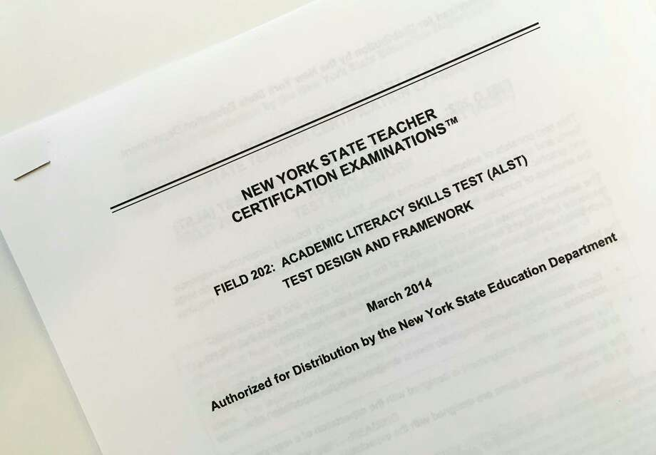 This March 8, 2017 photo shows the front page of a document explaining a certification exam known as the Academic Literacy Skills Test, designed to measure the reading and writing skills of aspiring teachers, in New York. New York state education officials are poised to scrap the test which critics say is racially biased, redundant and a poor predictor of who will succeed as teacher. But backers of the test say eliminating it could put weak teachers in classrooms. (AP Photo/Barbara Woike) ORG XMIT: NYR301 Photo: Barbara Woike / Copyright 2017 The Associated Press. All rights reserved.
