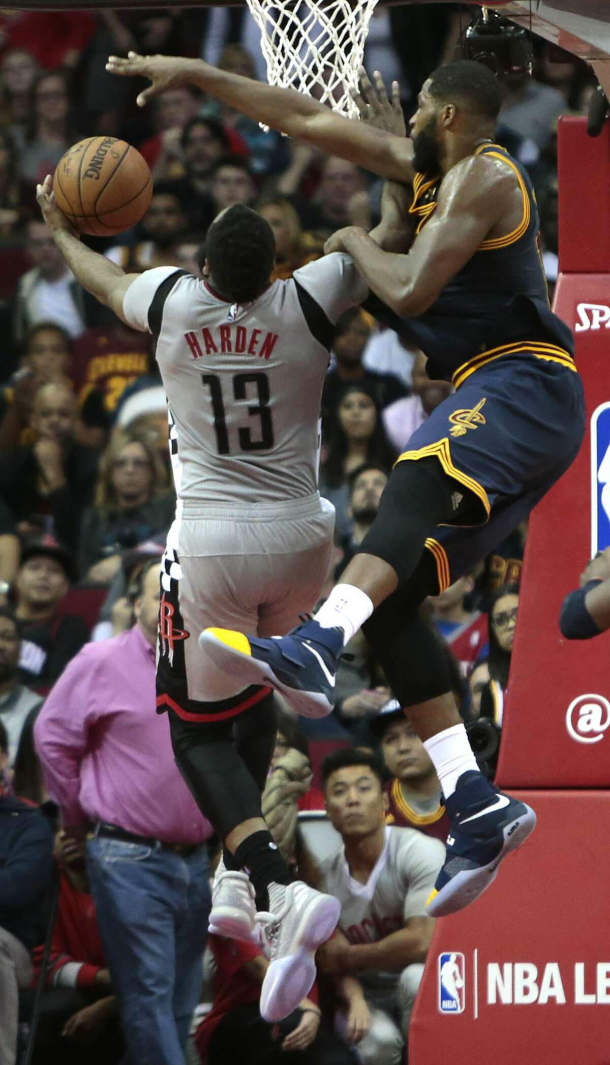 Houston Rockets guard James Harden (13) is fouled by Cleveland Cavaliers center Tristan Thompson (13) as he drives in for a layup during the fourth quarter of an NBA basketball game at Toyota Center on Sunday, March 12, 2017, in Houston. ( Brett Coomer / Houston Chronicle )