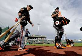 San Francisco Giants' Brandon Belt, right, and Joe Panik take the field during spring training baseball workouts, Friday, Feb. 17, 2017, in Scottsdale, Ariz. (AP Photo/Matt York)