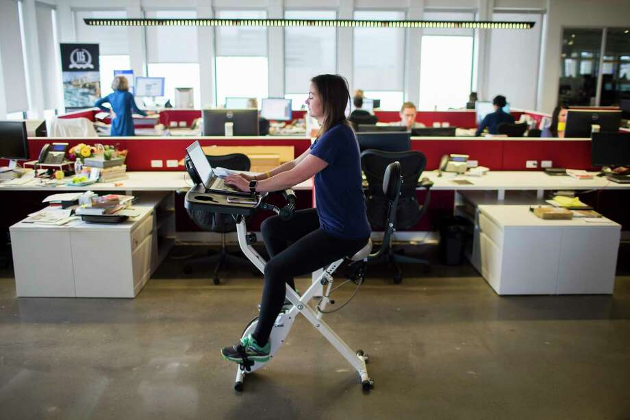 Houston Chronicle features reporter, Maggie Gordon works while exercising on a FitDesk, Wednesday, March 8, 2017, in Houston. ( Marie D. De Jesus / Houston Chronicle ) Photo: Marie D. De Jesus, Staff / © 2017 Houston Chronicle