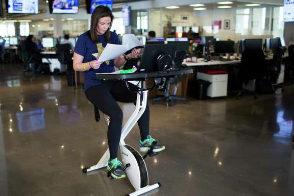 Houston Chronicle features reporter Maggie Gordon works while exercising on a FitDesk.