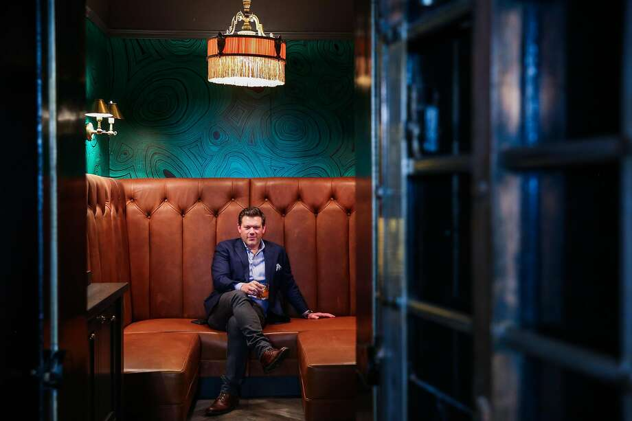 Chef Tyler Florence occupies the Sequoia's new power booth, located in a former bank vault presumably left over from when the building was a gold-measuring center. The new space on the fourth floor of the Wayfare Tavern was designed by Ken Fulk. Photo: Gabrielle Lurie, The Chronicle