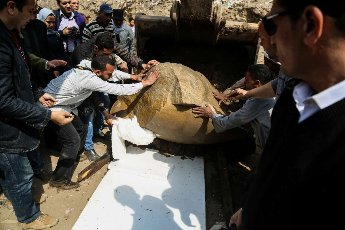 CAIRO, EGYPT - MARCH 8: A quartzite colossus possibly of Ramses II and limestone bust of Seti II are seen after they were discovered at the ancient Heliopolis archaeological site in Matareya area in Cairo, Egypt on March 9, 2017. The statues were found in parts in the vicinity of the King Ramses II temple in the temple precinct of ancient Heliopolis, also known as Oun, by a German-Egyptian archaeological mission. (Photo by Ibrahim Ramadan/Anadolu Agency/Getty Images)