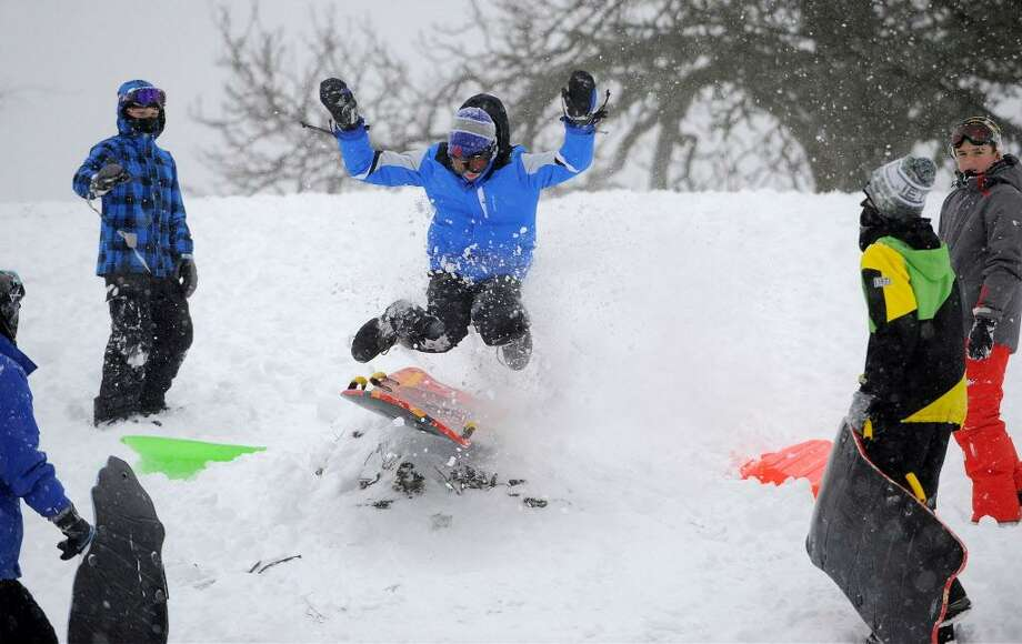 FILE — Children enjoy a snow day from school as they sled the hills of Cummings Park in Stamford on Feb. 9, 2017. Photo: Matthew Brown / Hearst Connecticut Media / Stamford Advocate