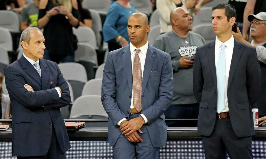 Spurs assistant coaches (from left) Ettore Messina (from left), Ime Udoka, and James Borrego watch warm-ups before the preseason game with the Houston Rockets on Oct. 21, 2016 at the AT&T Center. Photo: Edward A. Ornelas /San Antonio Express-News / © 2016 San Antonio Express-News