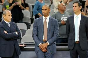 Spurs assistant coaches (from left) Ettore Messina (from left), Ime Udoka, and James Borrego watch warm-ups before the preseason game with the Houston Rockets on Oct. 21, 2016 at the AT&T Center.