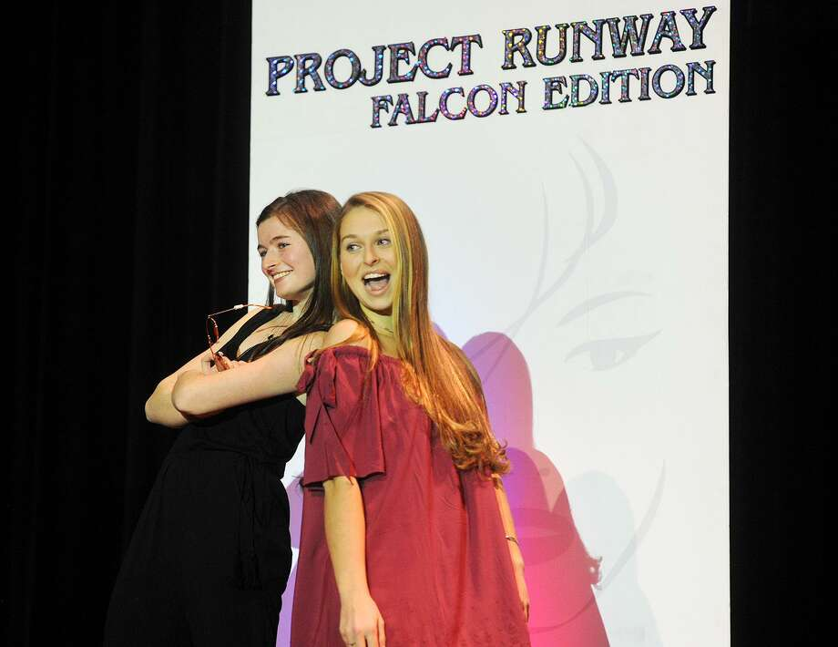 Fairfield Ludlowe High School students Kelly Kiremidjian and Caroline Wolstenholme strike a pose as they play to the audience during the school's 10th Annual Project Runway Falcon Edition fashion show at the school in Fairfield, Conn. on Sunday, March 12, 2017. Photo: Brian A. Pounds / Hearst Connecticut Media / Connecticut Post