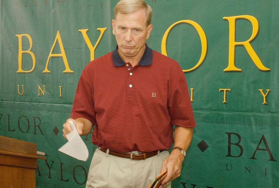 Baylor basketball coach Dave Bliss collects his notes after announcing his resignation on Aug. 8, 2003 in Waco. Bliss resigned Friday because of violations in his program that became known after the disappearance and death of a player allegedly killed by a former teammate. Baylor president Robert Sloan said the school has discovered major violations regarding players getting paid and improper drug testing. Photo: Associated Press File Photo / WACO TRIBUNE HERALD