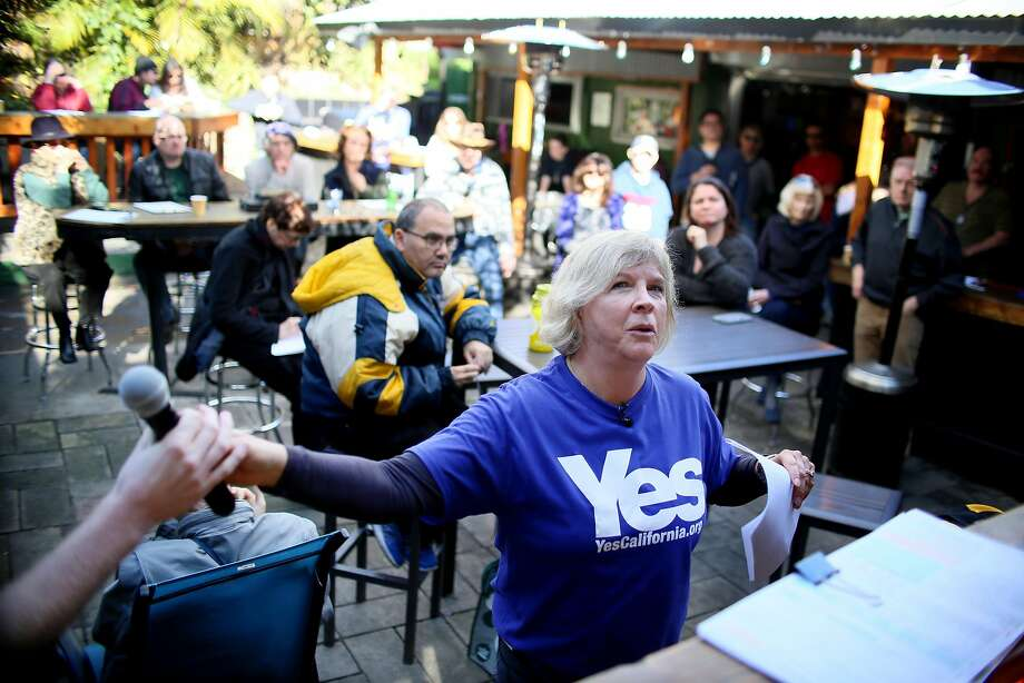 """Karen Sherman of Yes California, leads a secessionist meeting at the Hole in the Wall bar in San Diego. """"California is different from America,"""" says Marcus Ruiz Evans, co-founder of Yes California. """"California is hated. It's not liked. It's seen as weird."""" Must credit: Photo by Sandy Huffaker for The Washington Post Photo: Sandy Huffaker, For The Washington Post"""