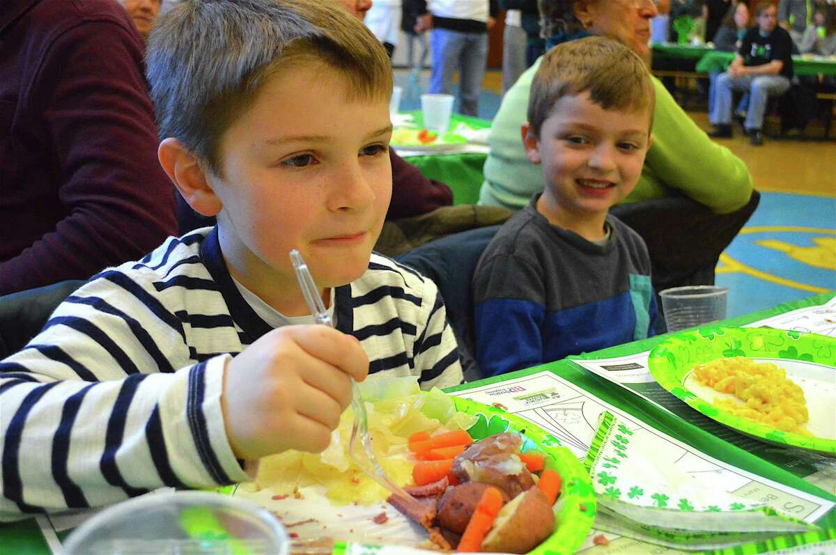 Conor Deasy, 9, left, of New Canaan, and his brother Sean, 6, enjoy the food.