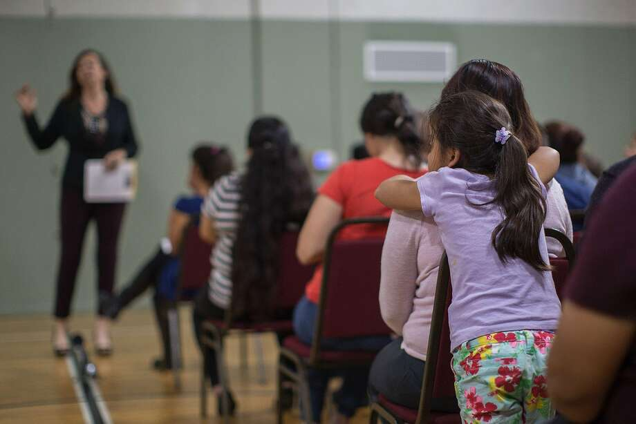 A girl watches during a workshop for immigrants to make a preparedness plan, in case they are confronted by immigration officials, at Academia Avance charter school where 48-year-old father of four, Romulo Avelica-Gonzalez, was recently arrested by ICE agents when he dropped off his daughter for school, on March 9, 2017 in Los Angeles. Photo: DAVID MCNEW, AFP/Getty Images
