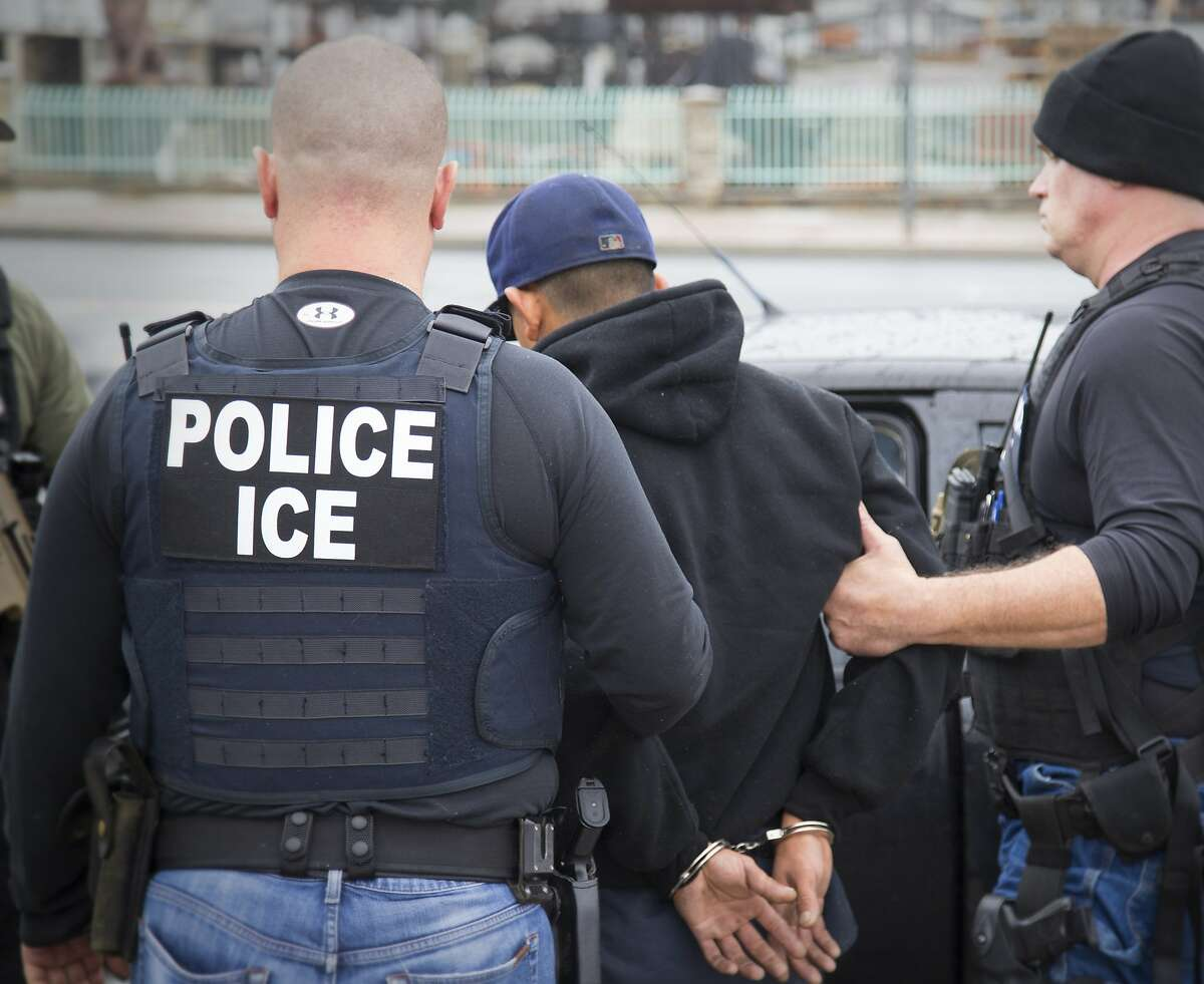 U.S. Immigration and Customs Enforcement agents make arrests on Feb. 7 during a Los Angeles operation.