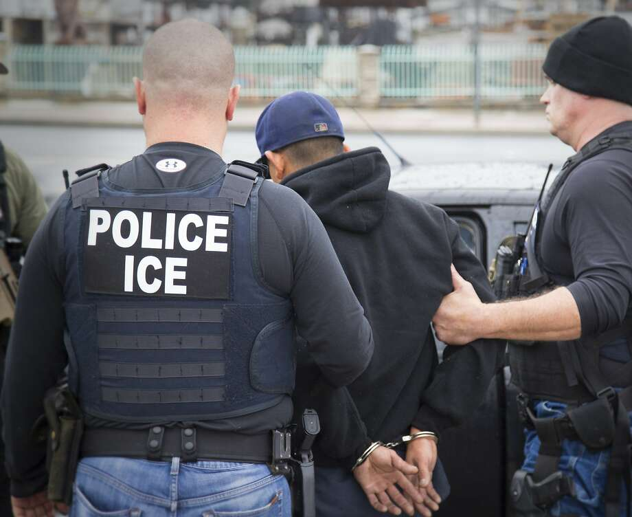 In this file photo foreign nationals are arrested during a targeted enforcement operation conducted by U.S. Immigration and Customs Enforcement (ICE) aimed at immigration fugitives, re-entrants and at-large criminal aliens in Los Angeles. ICE conducted  a sweep targeting sanctuary cities this week and arrested almost 500 people for immigration violations. Photo: Charles Reed, Associated Press
