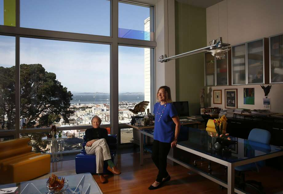 John Marx and Nikki Beach in the new living room, part of the modern add-on that Marx designed for their Russian Hill Edwardian home. Marx's blue desk (right) delineates his home office. Photo: Leah Millis, The Chronicle