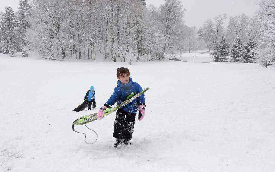 Jackson Rowley, 8, and Jack Thompson, 7, play in the snow at Winslow Park Friday, March 10, during the snowfall in Westport. About 2 to 4 inches fell over southern Connecticut, bringing bitter cold temperatures for the next few days. Photo: Erik Trautmann / Hearst Connecticut Media / Norwalk Hour