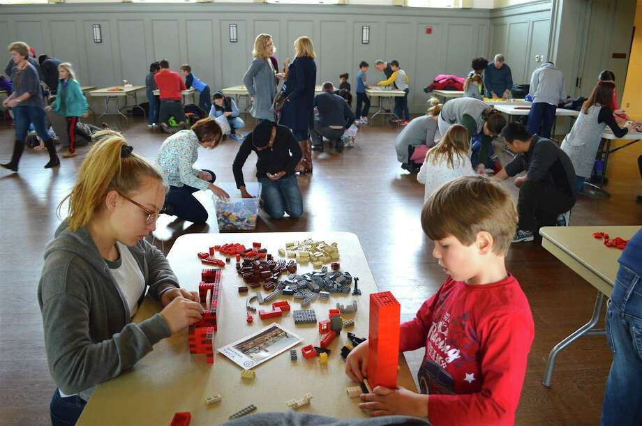 "Anja Gubitz, 13, of Westport, and her brother, Thomas, 5, at work at the Westport Historical Society's ""Come Build Westport — One Lego at a Time"" event held at Christ & Holy Trinity Church on Sunday. Photo: Jarret Liotta / For Hearst Connecticut Media / Westport News Freelance"
