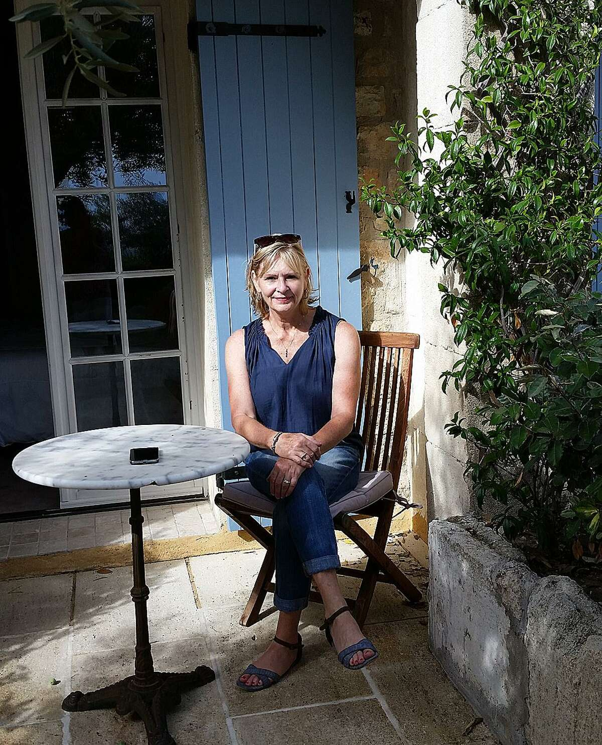 Dee Poquette, owner and founder of Jackdaw Brocante Cuisine Tours in New Fairfield, Conn., relaxes in Les Baux, France.